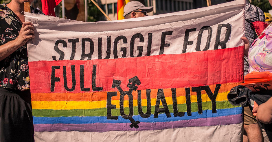"Banner with ""Struggle for full equality"" written on it"